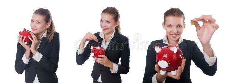 Коммерсантка женщины с piggybank на белизне стоковое изображение