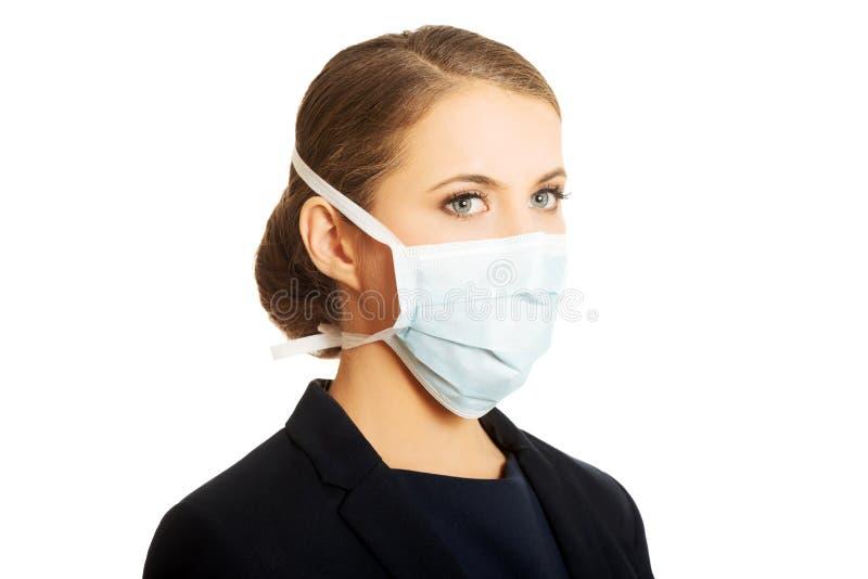 Коммерсантка с защищая маской стоковые фотографии rf