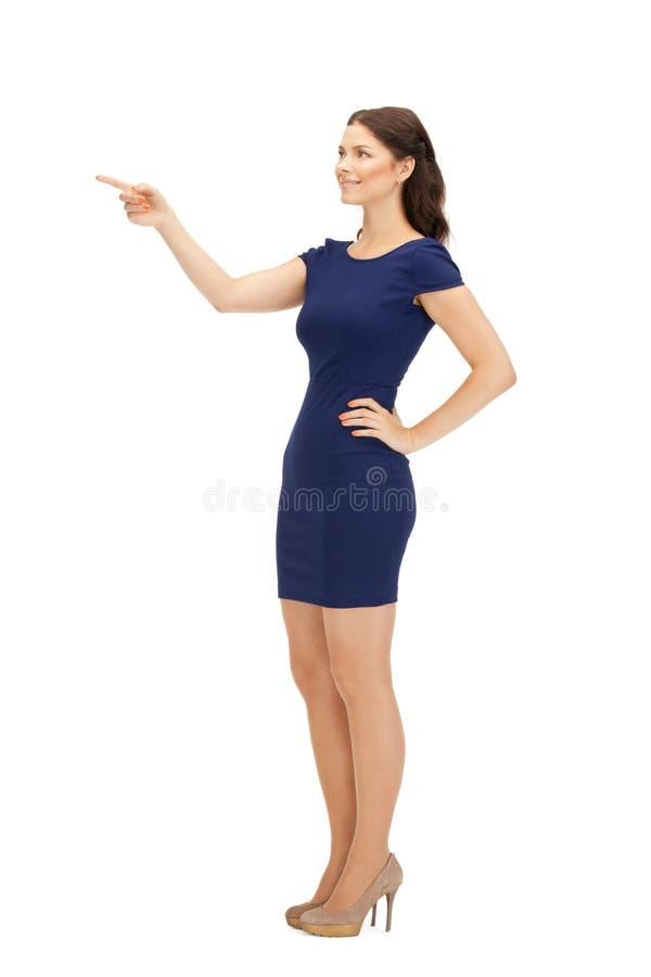 Коммерсантка указывая ее палец стоковое изображение