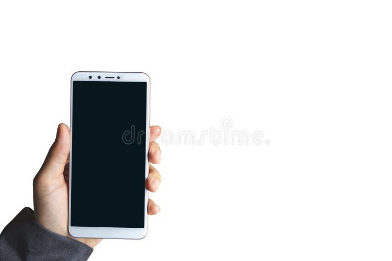 Коммерсантка улавливает предпосылку изолированную телефоном белую стоковая фотография