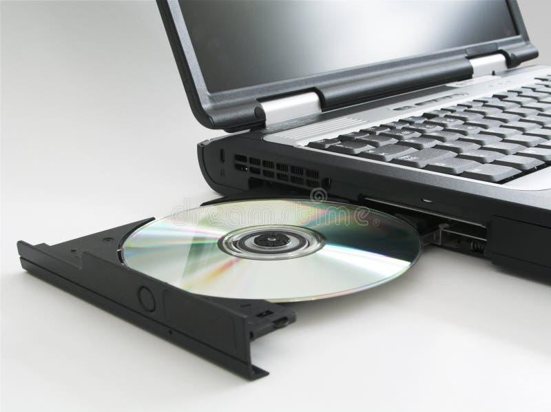компактный диск выкинул Ii компьтер-книжку W Стоковое фото RF