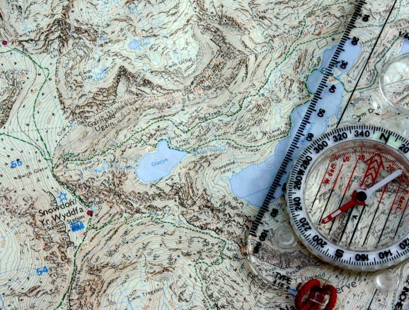 Компас и карта стоковые изображения