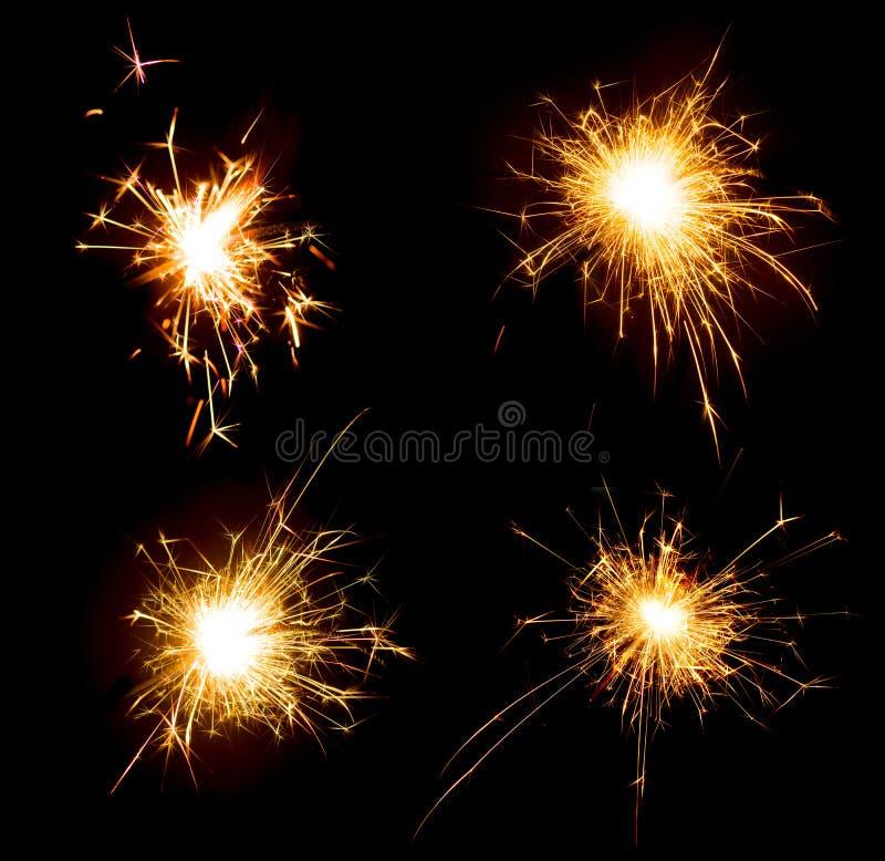 Комплект бенгальских огней праздника партии изолированных на черноте стоковое фото