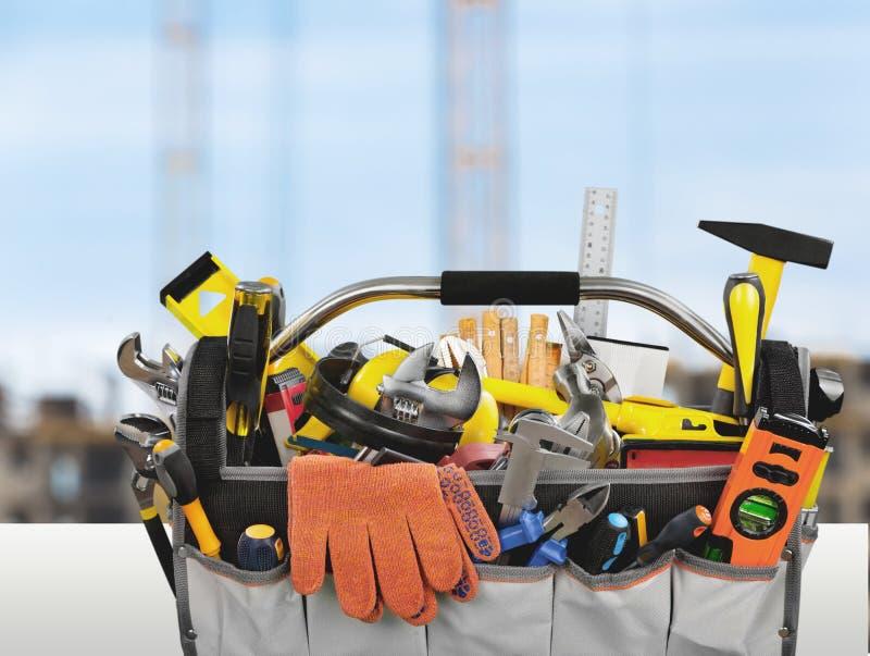 Комплект инструментов в коробке работы на предпосылке стоковое фото rf