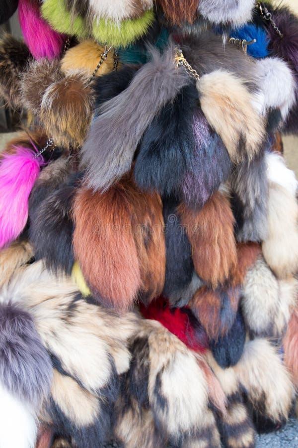 Комплект красочных pompoms в базаре стоковое фото rf