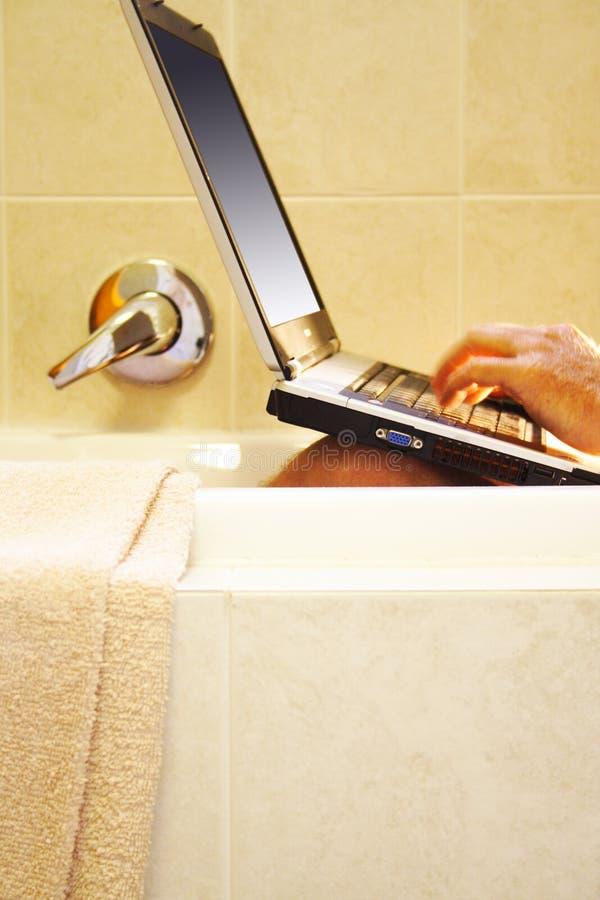 компьтер-книжка ванны стоковое изображение
