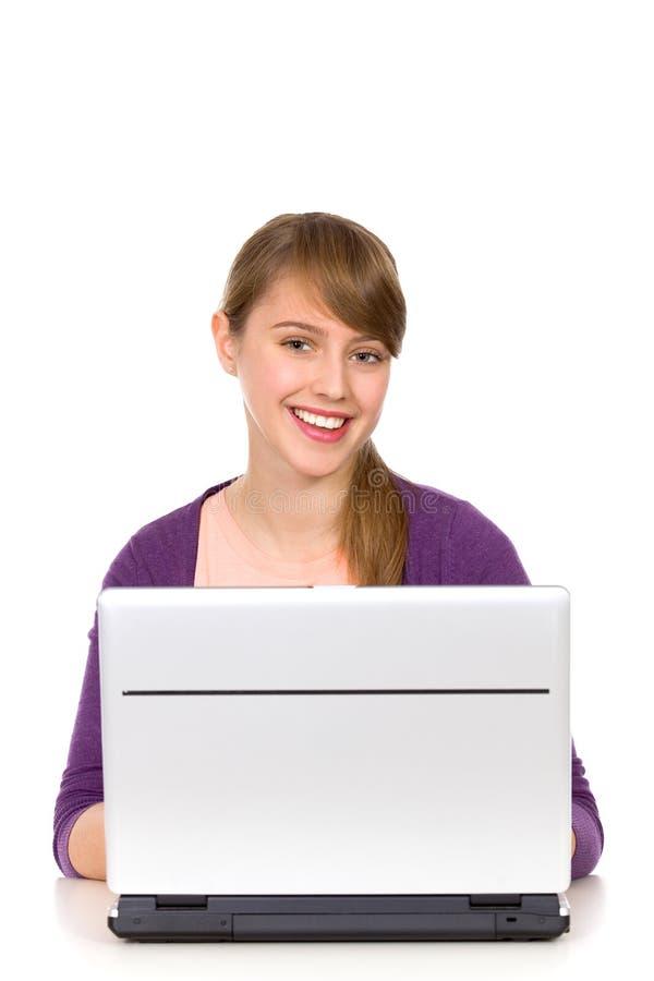 компьтер-книжка девушки используя стоковые изображения