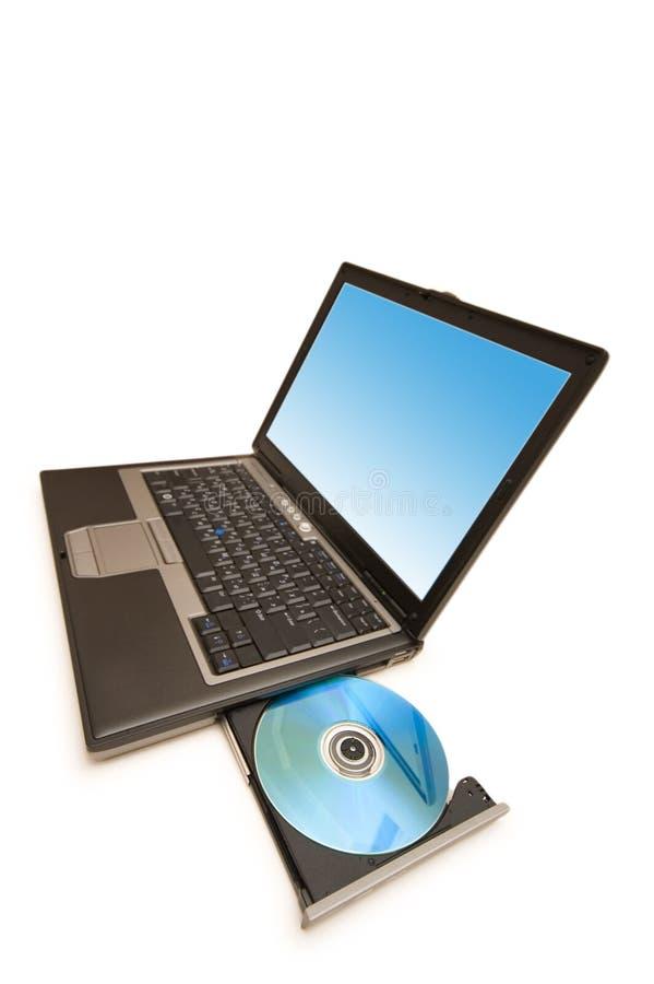 Компьтер-книжка и cd привод изолированные на белизне стоковые фотографии rf