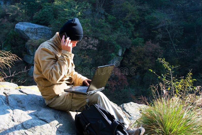 компьтер-книжка hiker стоковые изображения