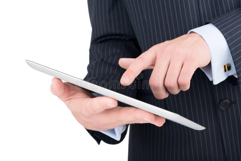 Компьютер таблетки в руках бизнесмена стоковое изображение