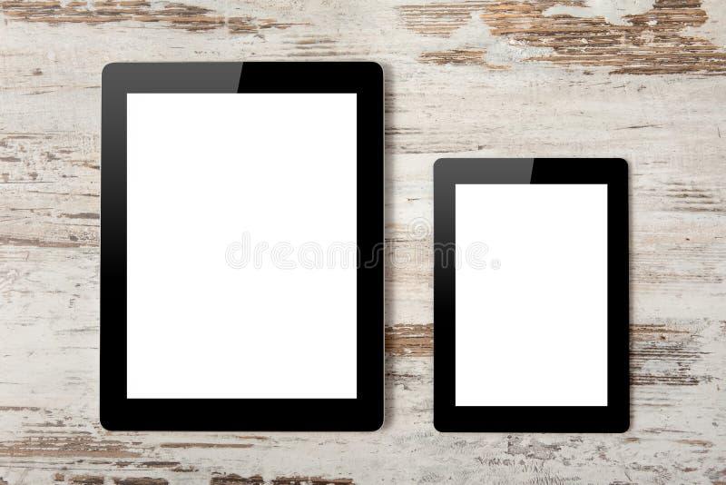 Компьютер таблетки и миниая с изолировано стоковые изображения