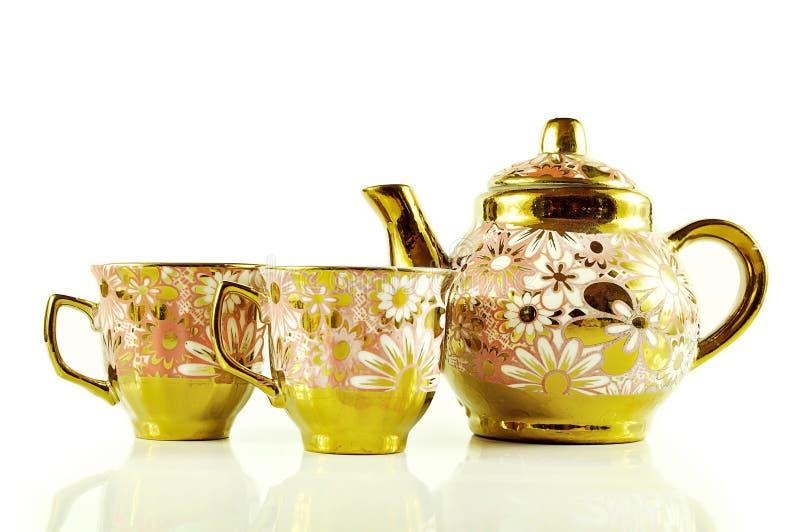 Комплекты чая закрывают вверх изолированный на белой предпосылке стоковые изображения rf