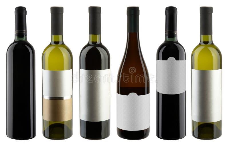 Комплект бутылок красных и белого вина стоковые изображения rf