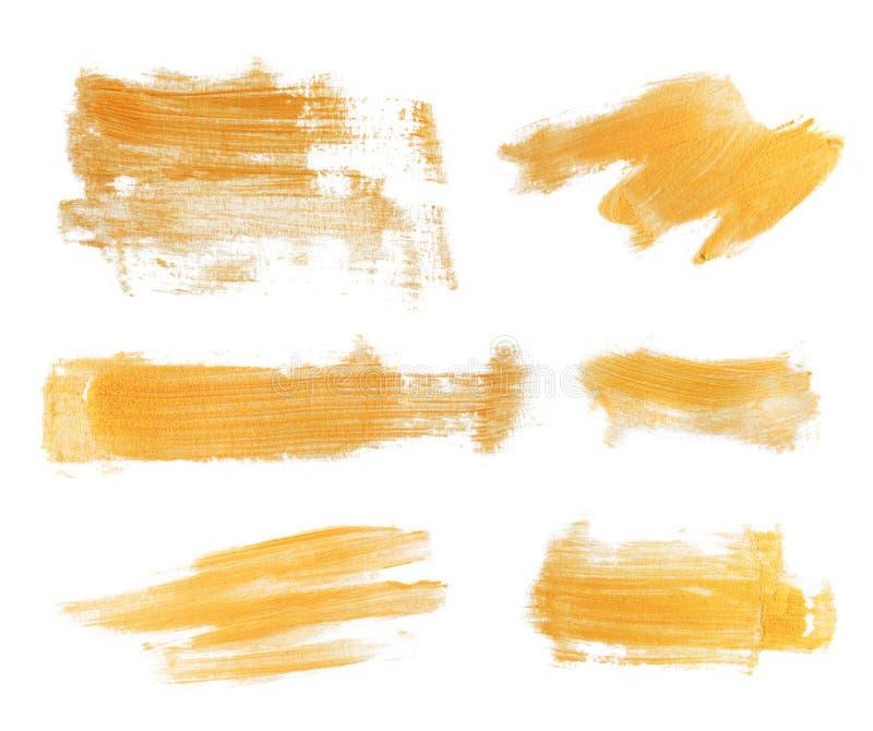 Комплект золотых ходов краски стоковые фотографии rf