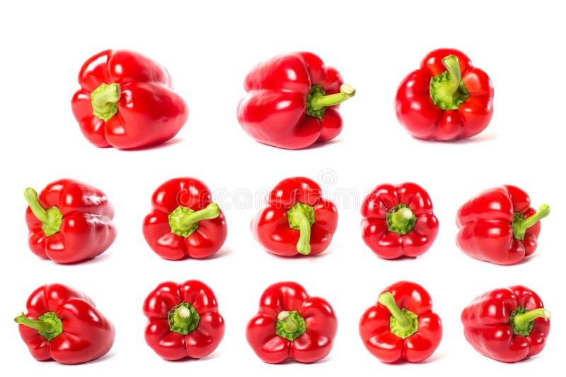 Комплект красных болгарских перцев изолированных на белой предпосылке стоковое изображение rf