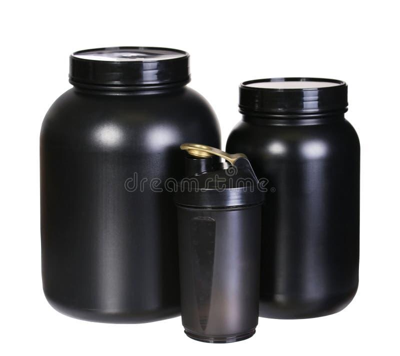Комплект питания спорта, протеин Whey и победитель. Черные опарникы пластмассы стоковая фотография rf