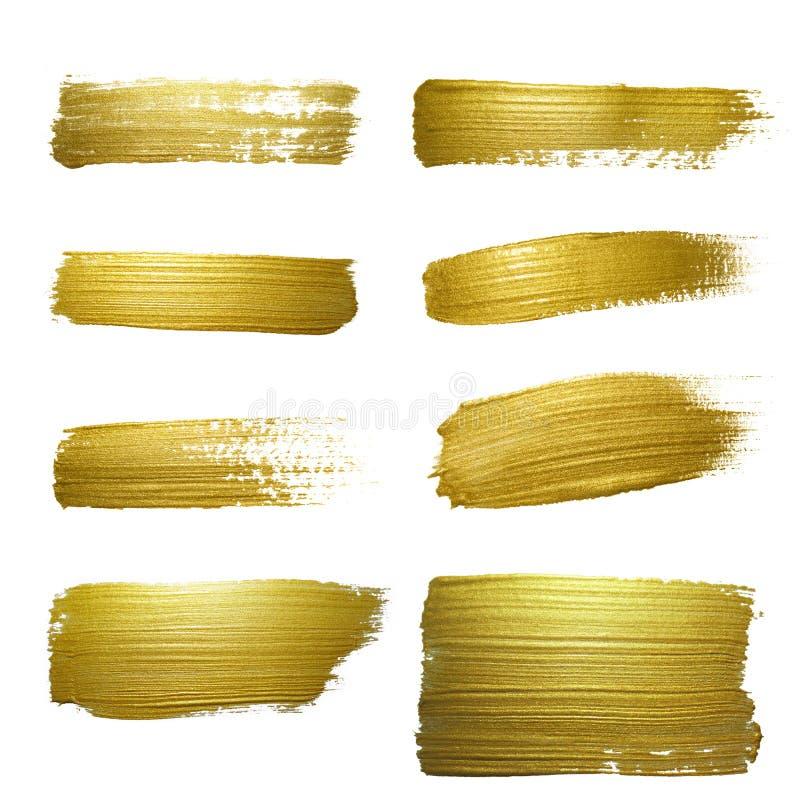 Комплект пятна хода мазка краски золота стоковая фотография rf