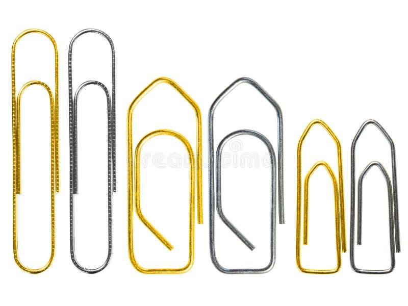 Комплект различного зажима золотого и стального grounge бумажного изолированного на белом конце предпосылки вверх стоковое изображение rf