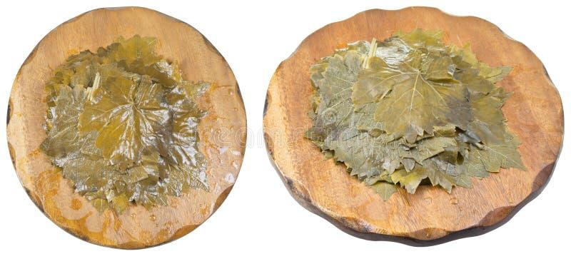 Комплект marinated виноградины выходит на деревянные доски стоковая фотография