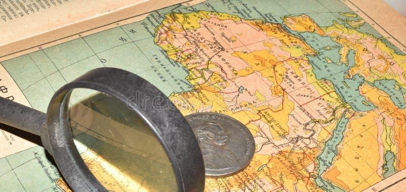 Конго, монетка и стекла стоковые изображения