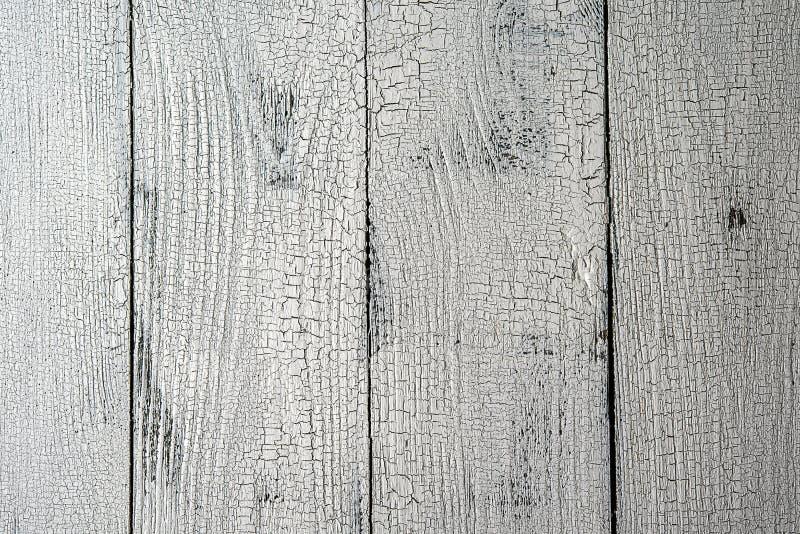 Конец-вверх вертикальных белых достигших возраста деревянных планок стоковое фото