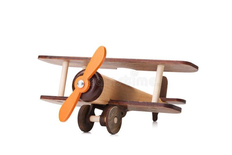 Конец-вверх дружественного к эко продукта для игр ` s детей, изолированного на белой предпосылке Превращаясь самолет игрушки стоковое фото