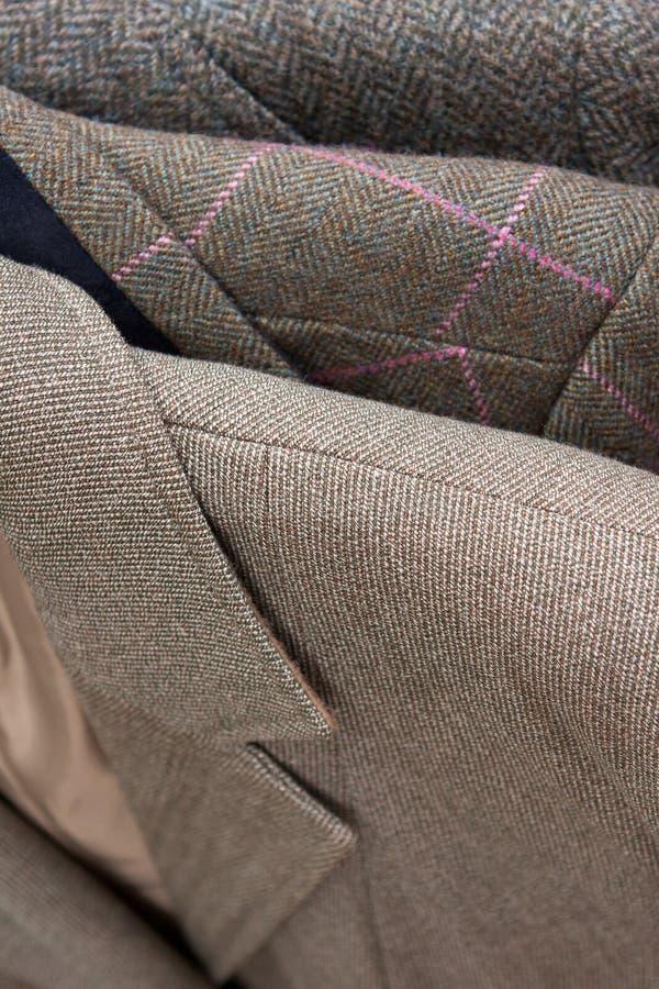 Конец-вверх детали курток одежды из твида стоковая фотография
