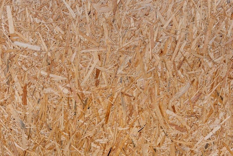 Конец вверх отжал деревянную предпосылку панели, безшовную текстуру ориентированной доски стренги - древесины OSB - изображение стоковые фото
