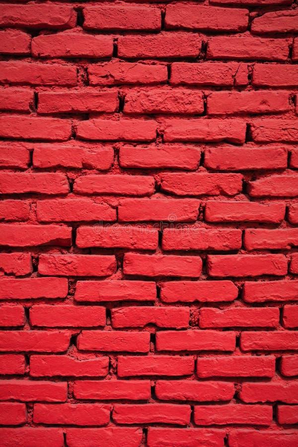 Конец-вверх покрашенной кирпичной стены красной стоковая фотография