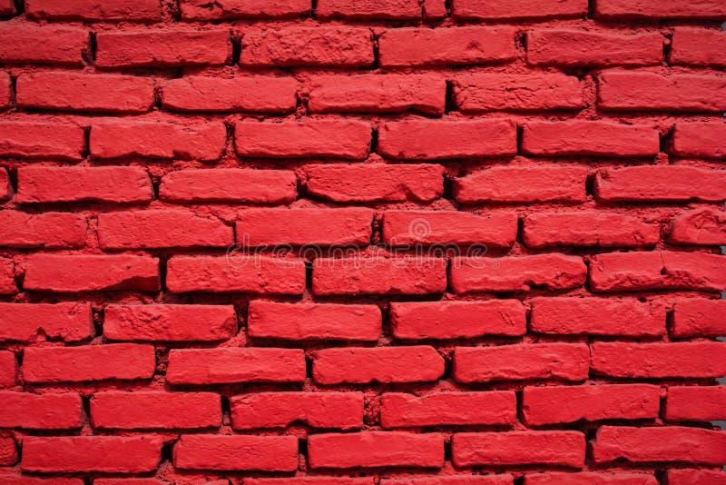 Конец-вверх покрашенной кирпичной стены красной стоковое изображение