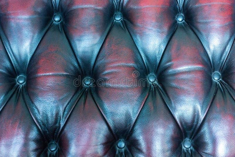 Конец вверх по винтажной коже предпосылки текстуры софы стоковые изображения