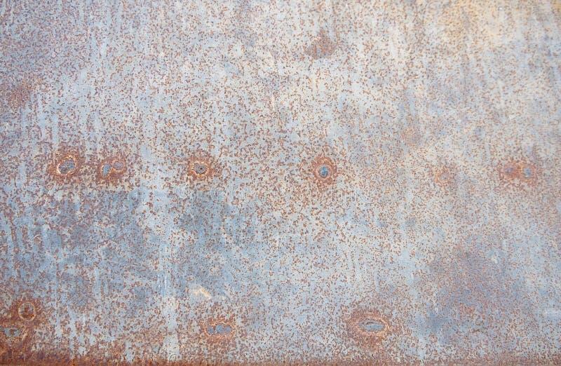 Конец вверх по ржавчине на поверхности старого утюга, старой стальной предпосылке конспекта доски металлического листа стоковая фотография