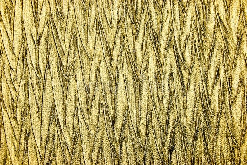 Конец вверх по роскошному металлическому материалу золота стоковые фото