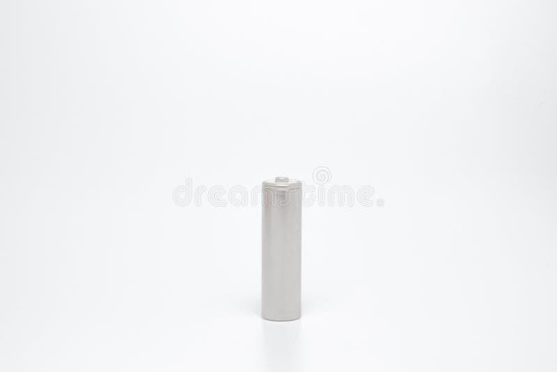 Конец вверх по серым батареям AA над белой предпосылкой с путем клиппирования стоковое изображение