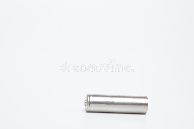 Конец вверх по серым батареям AA над белой предпосылкой с путем клиппирования стоковое фото rf