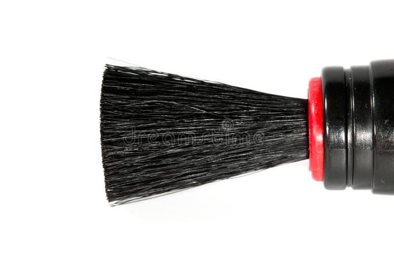 Конец вверх ручки чистки объектива с щеткой, вид спереди, изолированным на белой предпосылке стоковое фото