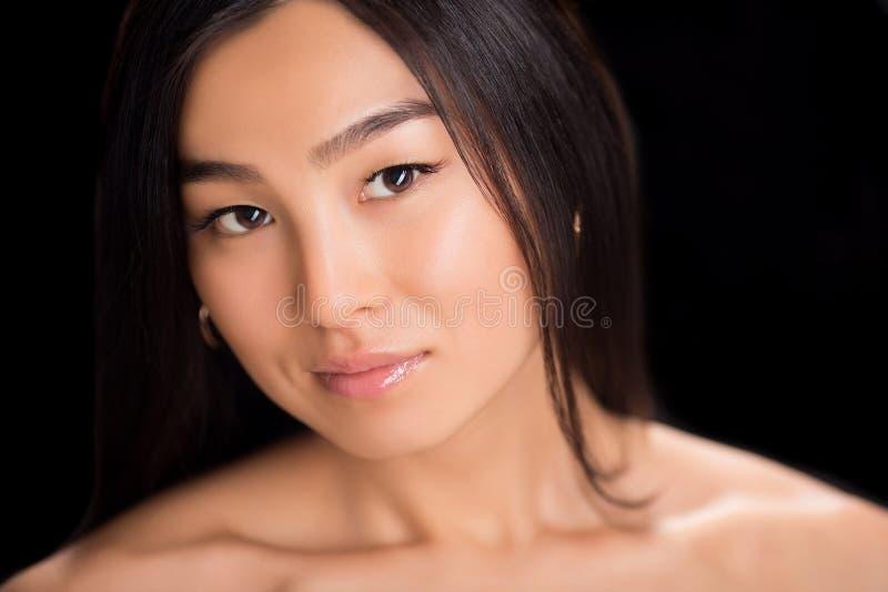 Конец-вверх стороны азиатской дамы стоковая фотография