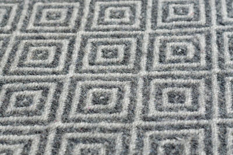 Конец-вверх текстуры шерстяной ткани Серый ромбовидный узор контраста стоковое изображение