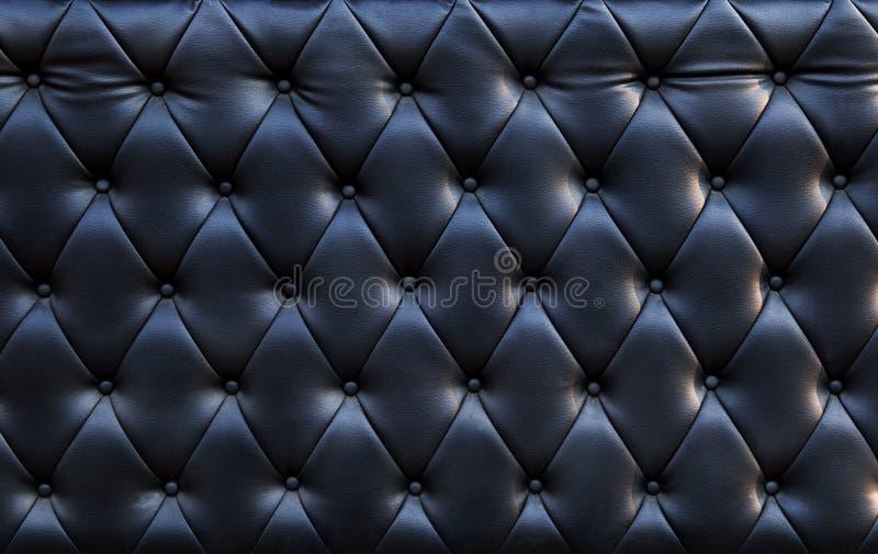 Конец вверх черноватой роскошной пользы текстуры кожи софы как текстурировано стоковое фото rf