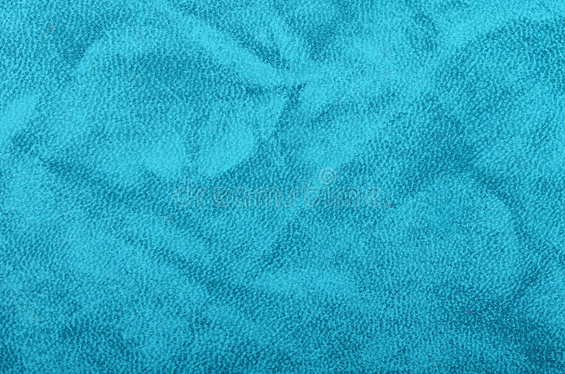 Конец голубой бумаги вверх стоковые фото