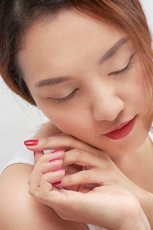 Конец женщины красоты азиатский вверх по стороне стоковое изображение