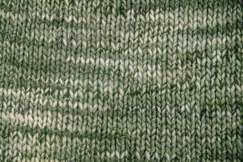 Конец текстуры шарфа шерстей вверх Связанная предпосылка jersey с re стоковое изображение