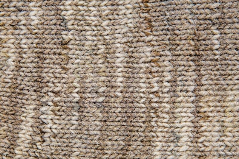 Конец текстуры шарфа шерстей вверх Связанная предпосылка jersey с re стоковые фотографии rf