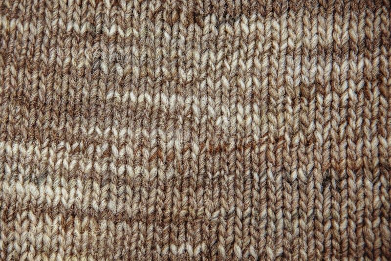 Конец текстуры шарфа шерстей вверх Связанная предпосылка jersey с re стоковая фотография