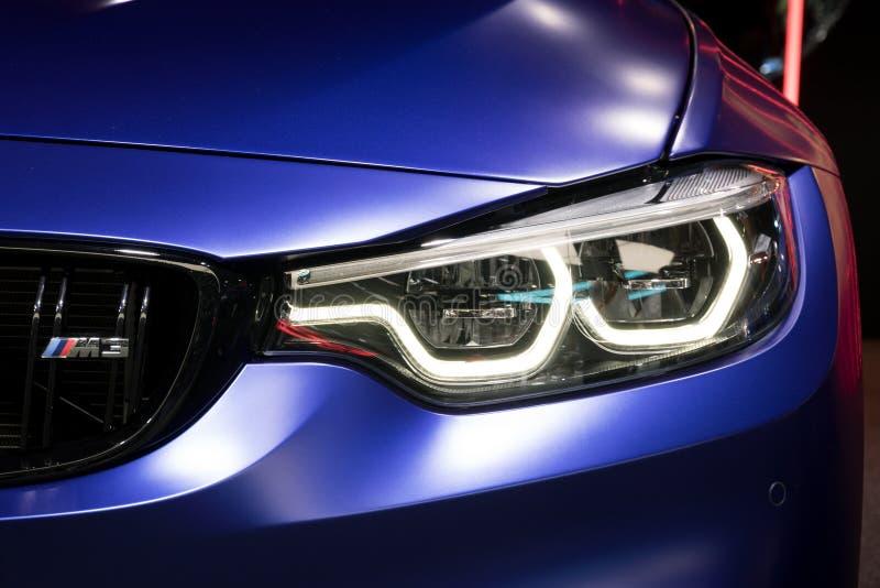 Конец фары BMW M3 вверх стоковые изображения