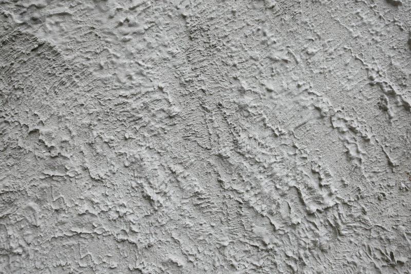 Конкретная предпосылка на покрытой каменной стене - сером текстурированном фоне стоковые фото
