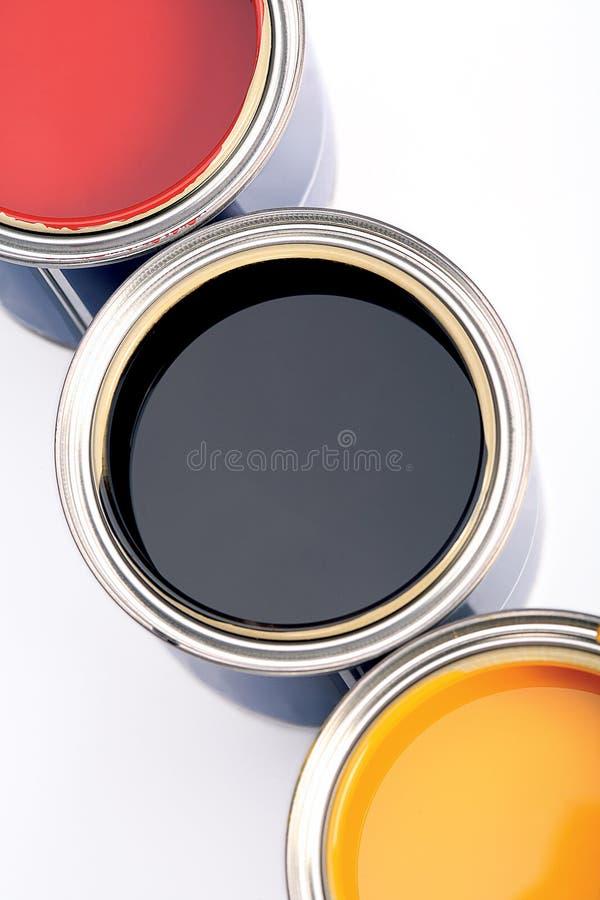 3 консервной банки краски стоковые изображения