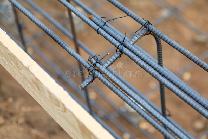Конспект новой стальной арматуры обрамляя на строительной площадке стоковая фотография rf