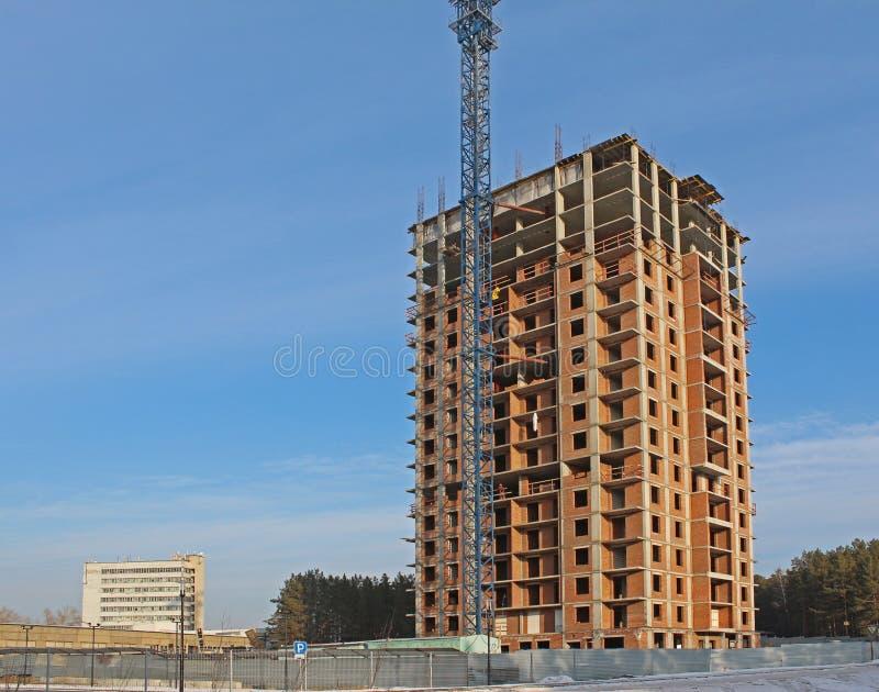 Конструкция дома высотного здания стоковое фото