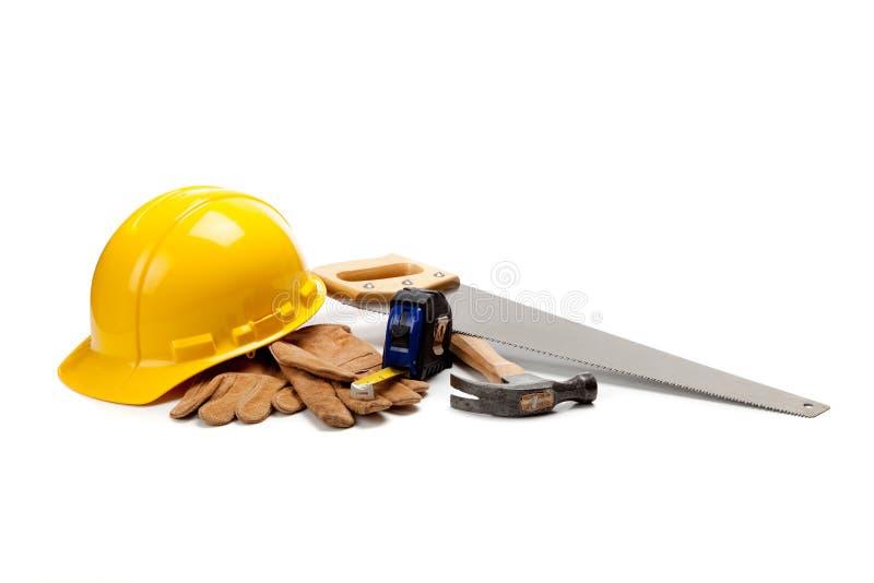 конструкция поставляет белого работника стоковая фотография rf